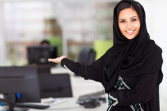 Arabian businesswoman presenting. Attractive young Arabian businesswoman presenting office Royalty Free Stock Images