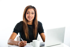 Attractive young asian indian teenage woman, studying with lapto Royalty Free Stock Image