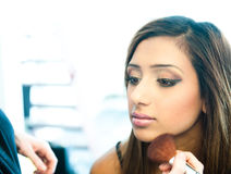 Attractive young asian indian woman having her make up done Stock Photo