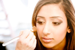 Attractive young asian indian woman having her make up done Royalty Free Stock Photos