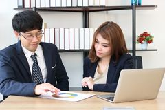 Attractive young Asian investment advisor business woman discussing to her client royalty free stock images
