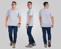 Young Man Standing, Grey Shirt Mock Up. Attractive young Asian man standing posing wearing plain grey shirt, blank t-shirt mock up for  printing, front back side Stock Image