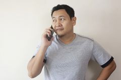Young Man Talking on his Phone, Happy Smiling Laughing royalty free stock image