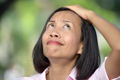 Minority Adult Female Memory Problems. An attractive young asian person royalty free stock image