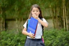 Startled Catholic Minority School Girl Wearing Uniform With Books