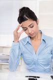 Attractive young asian secretary has migraine or headache. Royalty Free Stock Photography