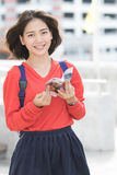 Attractive young asian student traveling outdoor smiling face wi Stock Photo