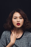 Attractive young asian woman in a black dress. Stylish girl mode Stock Photo