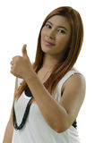Attractive young Asian woman giving a thumbs up isolate on white Royalty Free Stock Photos