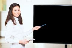 Asian businesswoman shows blank screen Stock Photos