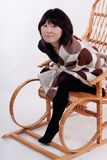 Attractive young Asian woman sitting in the rockin Royalty Free Stock Photos