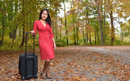 Attractive young Asian woman with suitcase Royalty Free Stock Photos