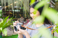 Attractive young asian woman talking pictures outdoors Royalty Free Stock Photo