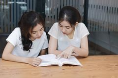 Attractive young Asian women with a book in living room royalty free stock images