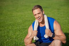 Attractive young athlete is resting after training Stock Photos