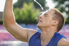 Attractive young athlete is very hot and tired Royalty Free Stock Photo