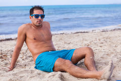 Attractive young athletic man on the beach Royalty Free Stock Image