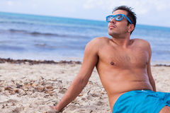 Attractive young athletic man on the beach Stock Photo