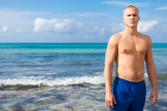 Attractive young athletic man on the beach Stock Photography
