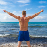 Attractive young athletic man on the beach Royalty Free Stock Photography