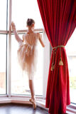 Attractive young ballerina  near a window Stock Image