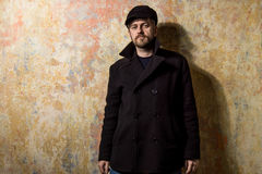 Attractive young bearded man in a pea coat Stock Image