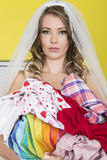 Attractive Young Beautiful Bride Holding Dirty Laundry Royalty Free Stock Photography