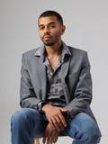 Attractive young black guy in gray blazer Stock Photos