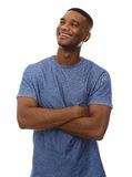 Attractive young black man smiling with arms crossed Royalty Free Stock Photo