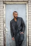 Attractive young black man standing in door way Royalty Free Stock Photo