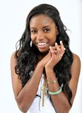 Attractive young black woman - eager anticipate. Expression series - attractive African-American young woman smiling and hands together - excited or anticipation Royalty Free Stock Photography