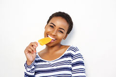 Attractive young black woman eating ice cream Royalty Free Stock Image