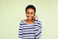 Attractive young black woman listening to mobile phone Royalty Free Stock Image