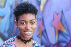 Attractive young black woman with short haircut Stock Photography