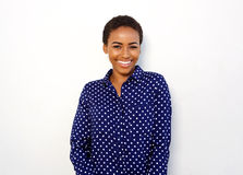 Attractive young black woman smiling against isolated white background Royalty Free Stock Image