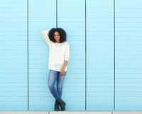 Attractive young black woman smiling outdoors. Full length portrait of an attractive young black woman smiling outdoors Stock Photos