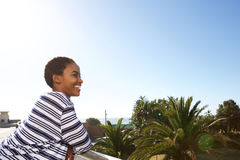 Attractive young black woman standing outside looking at view Stock Photos