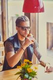 A man sits at the table in a cafe. royalty free stock photo