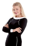Attractive young blond businesswoman standing with her arms crossed Royalty Free Stock Photography