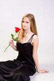Attractive young blond with fresh rose. Stock Photo