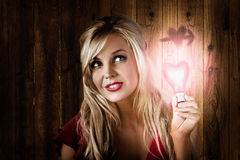 Attractive young blond girl holding love light Stock Photo