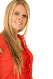 Attractive young blond haired woman smiling wearing red shirt Royalty Free Stock Photo