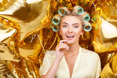 Attractive young blond housewife on astounding Stock Photography