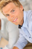 Attractive young blond man with blue eyes Stock Photos