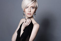 Attractive young blond woman with large crystal earrings Royalty Free Stock Photography
