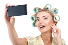 Attractive young blond woman is making selfie Stock Images