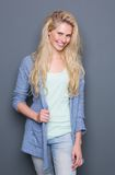 Attractive young blond woman smiling Stock Photos