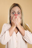 Attractive young blond woman is surprised. Royalty Free Stock Images