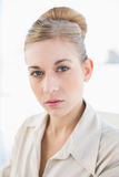Attractive young blonde businesswoman looking at camera Stock Images