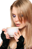Attractive young blonde with a cup of tea. Isolated Royalty Free Stock Image